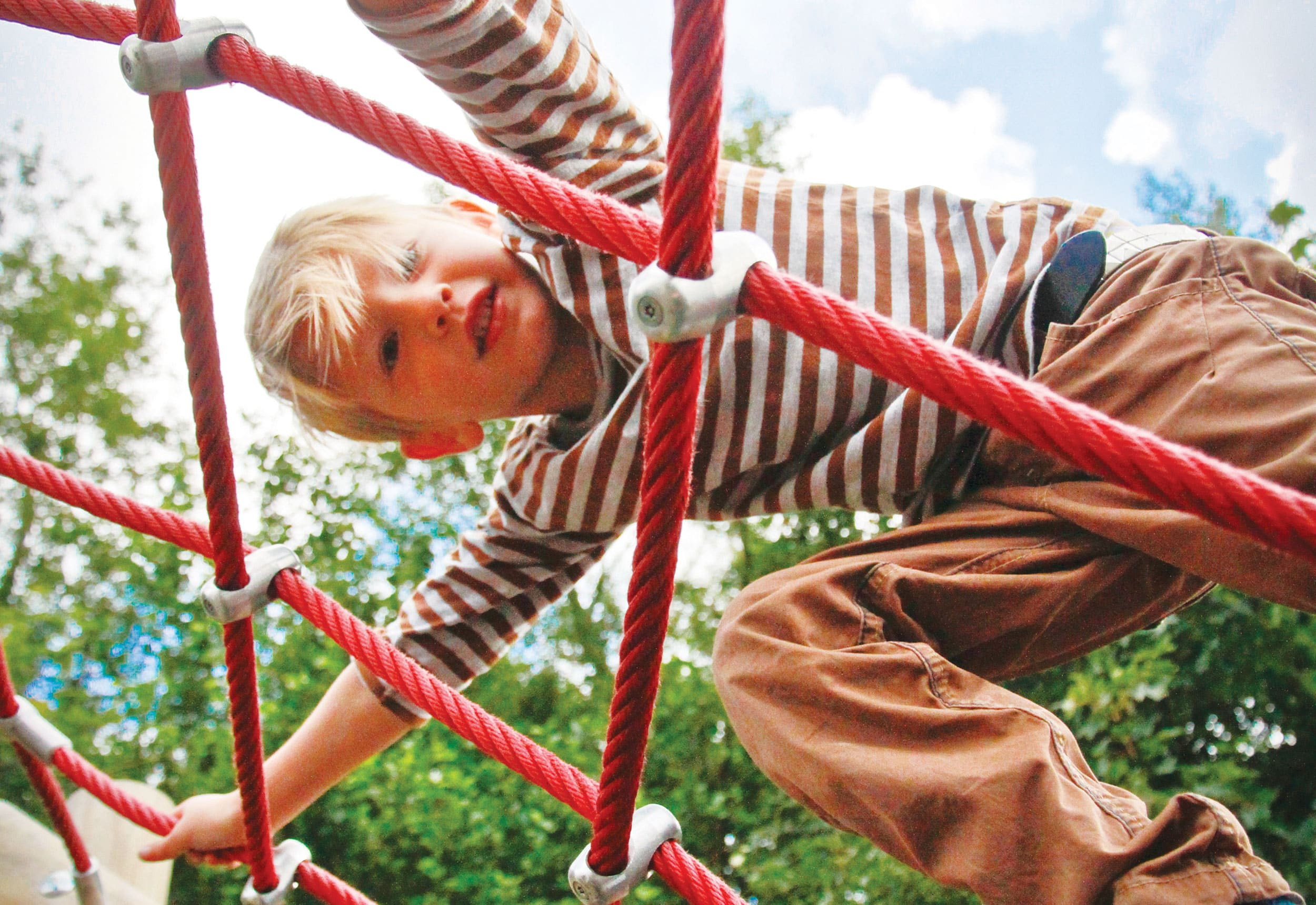 Playground Equipment for Schools and Nurseries, child climbing on climbing frame.